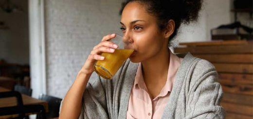 black-woman-drinking-juice
