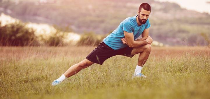 man-stretching-in-field