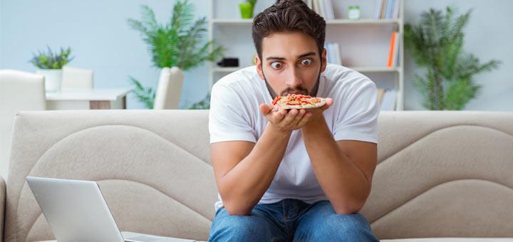 man-staring-at-pizza