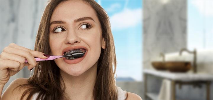 girl-charcoal-teeth-brushing